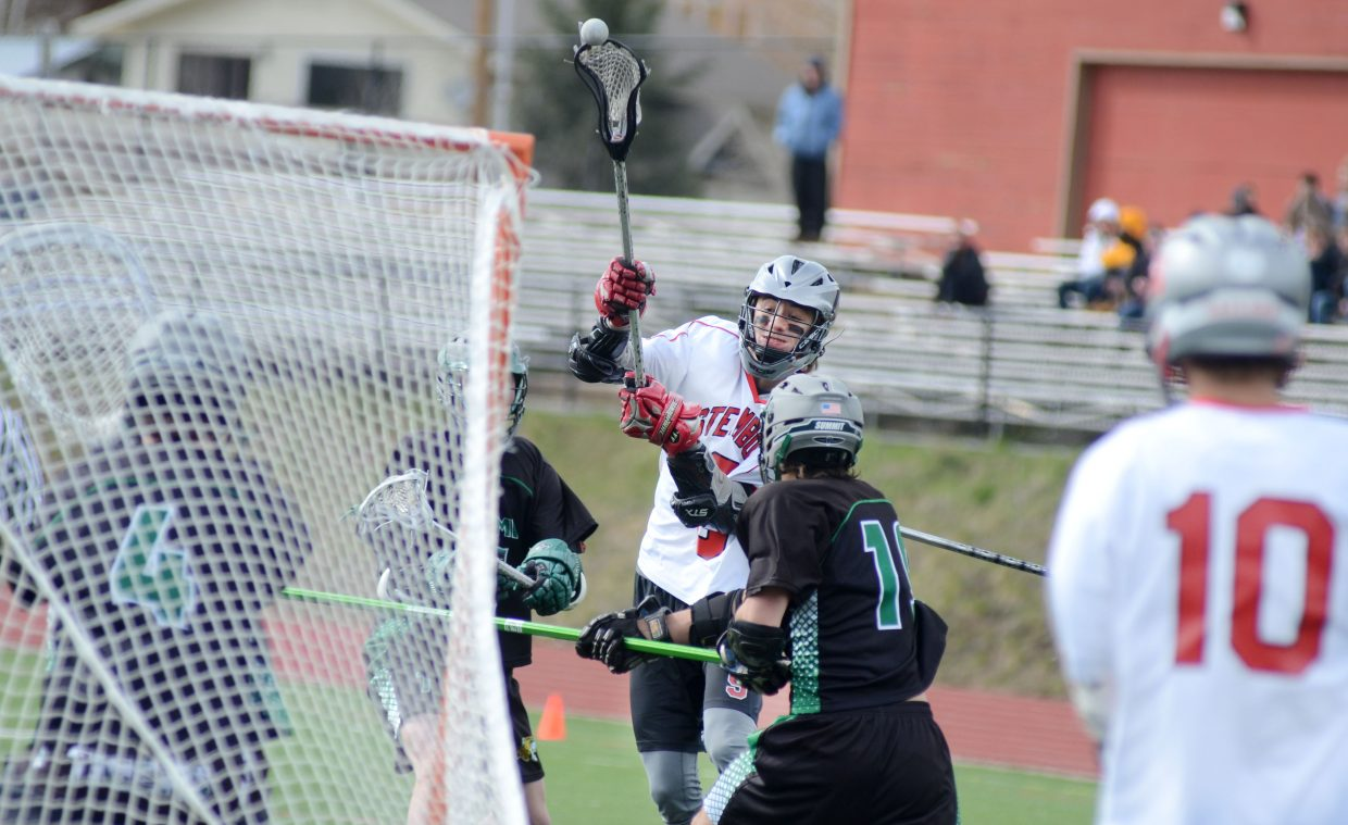 Steamboat Springs High School senior Andrew Firestone fires a shot at Summit goalie Jordan Nelson in the first half of the Sailors' 8-7 win Thursday night.