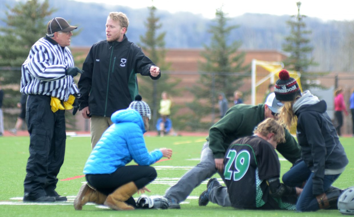 Summit boys lacrosse coach Michael Grinnell argues with the official about a no-call in the second half of Steamboat Springs High School's 8-7 over the Tigers.
