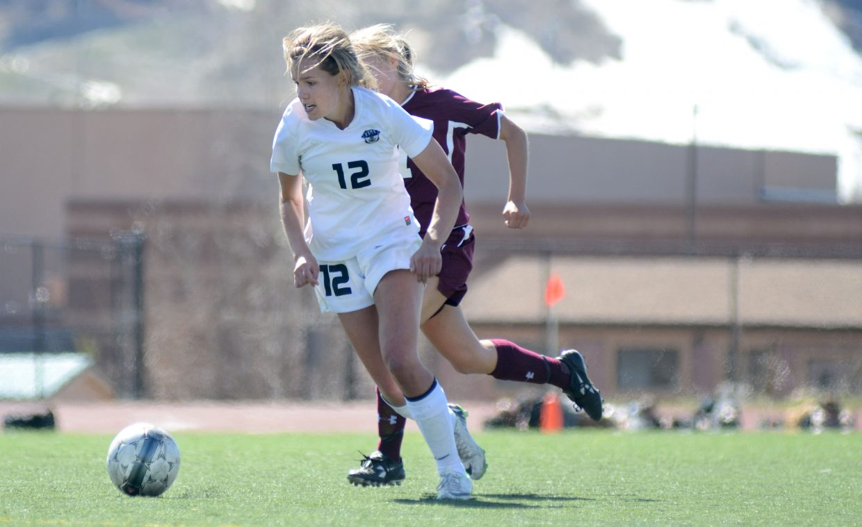 Steamboat Springs High School junior Natalie Bohlmann runs down the ball just before she boots the game-winning kick on Saturday in the Sailors' 1-0 victory over Palisade.