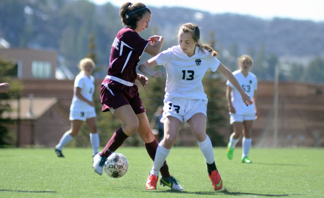 Steamboat Springs' Mackenzie Gansmann battles for possession of the ball with a Palisade player during the second half of the Sailors' 1-0 win on Saturday.