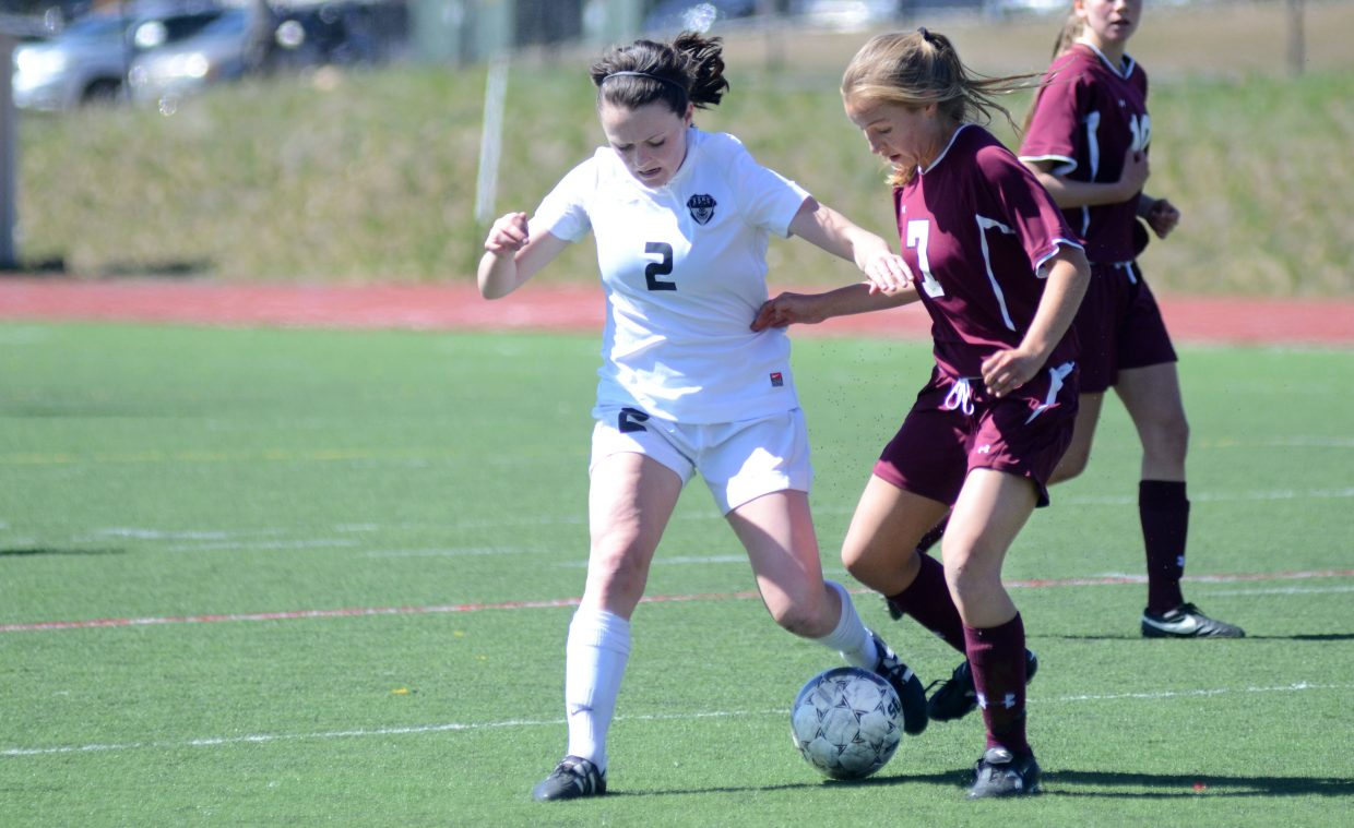Steamboat Springs' Jordi Floyd tries to dribble by Palisade's Brier Youngfleish in the second half of the Sailors' 1-0 victory on Saturday.