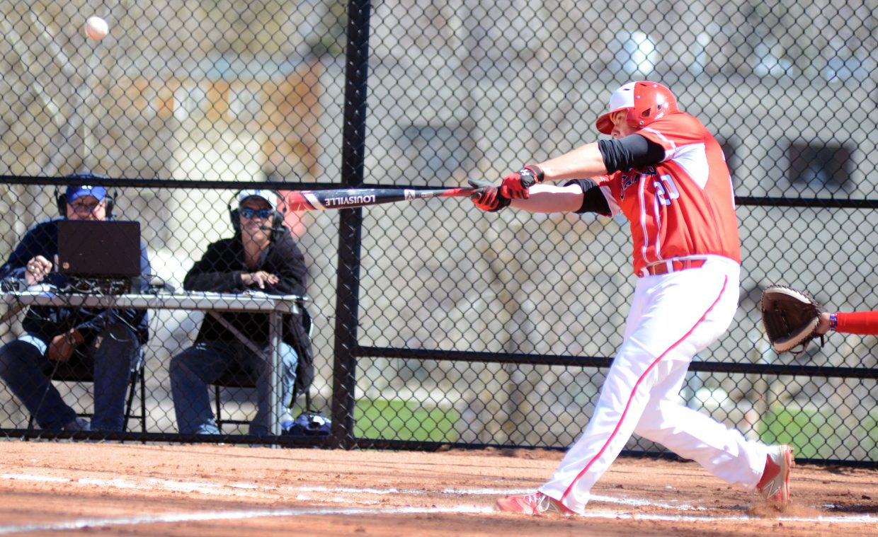 Steamboat Springs High School freshman David Brown slams a home run during Game 1 of Saturday's doubleheader against Glenwood Springs. Brown drove in three runs in the Sailors' 3-0 opening win, but the Demons ran by Steamboat in Game 2, 10-0.