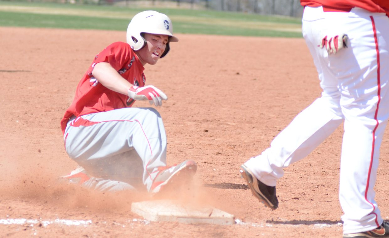 Glenwood Springs' Cooper Cornelius slides safely into third base in Game 1 of Saturday's doubleheader with Steamboat Springs.