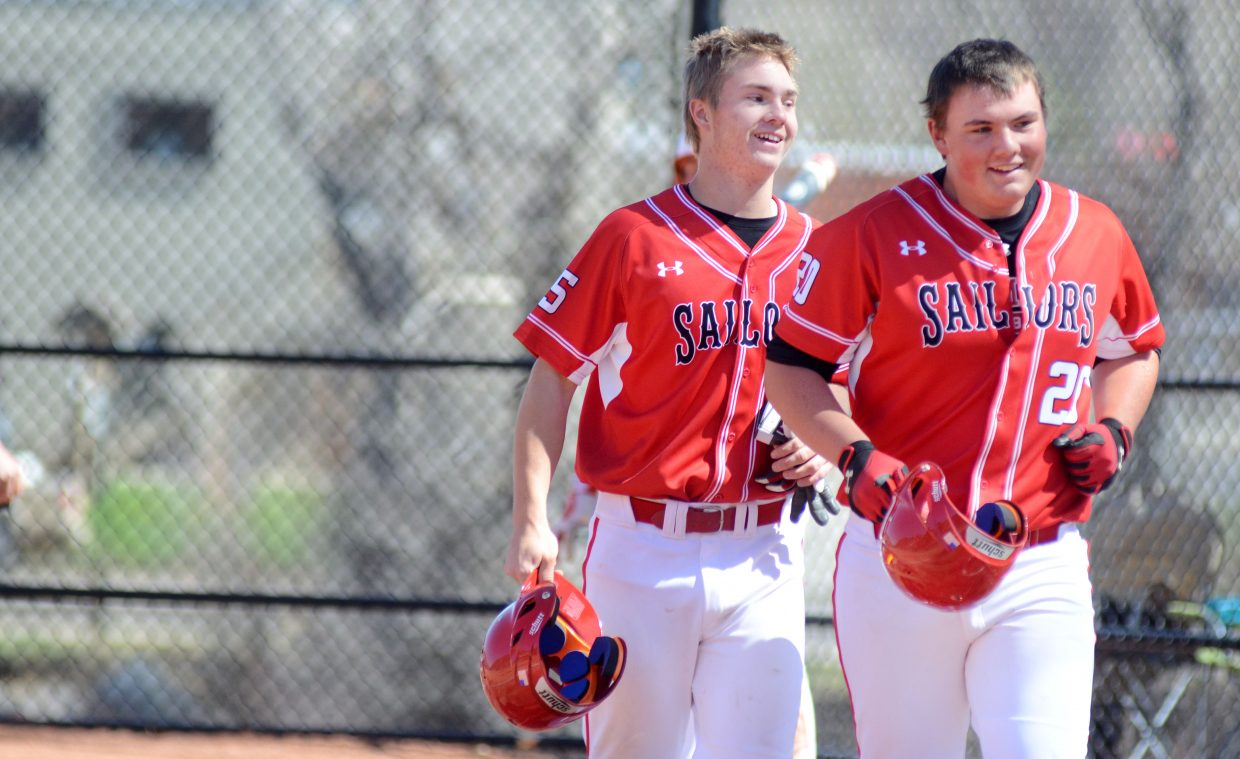 Steamboat Springs freshman David Brown, right, celebrates with Sailors senior Billy Clark after Brown's first-inning home run in Game 1 of Saturday's doubleheader against Glenwood Springs.