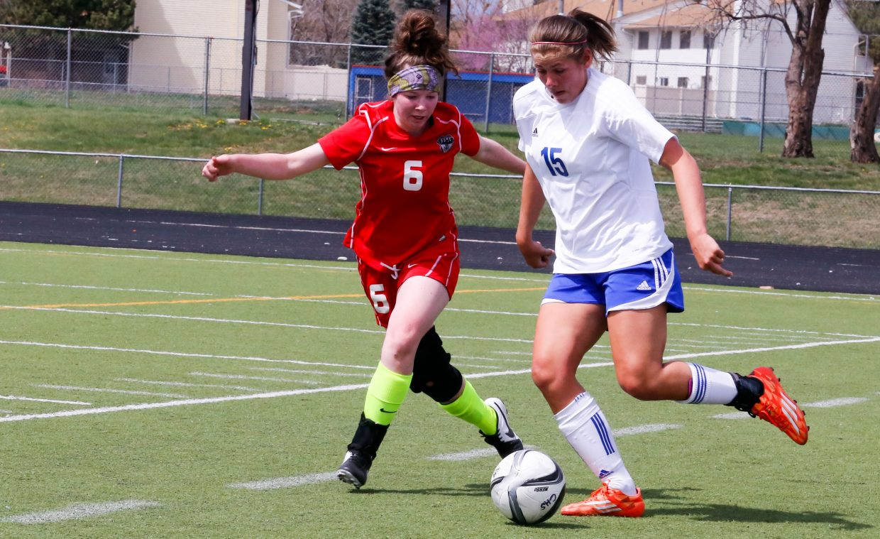 Steamboat Springs' Carolyn Walters puts pressure on Centaurus' Allison Ebersole during the two teams' 1-1 draw on Saturday.
