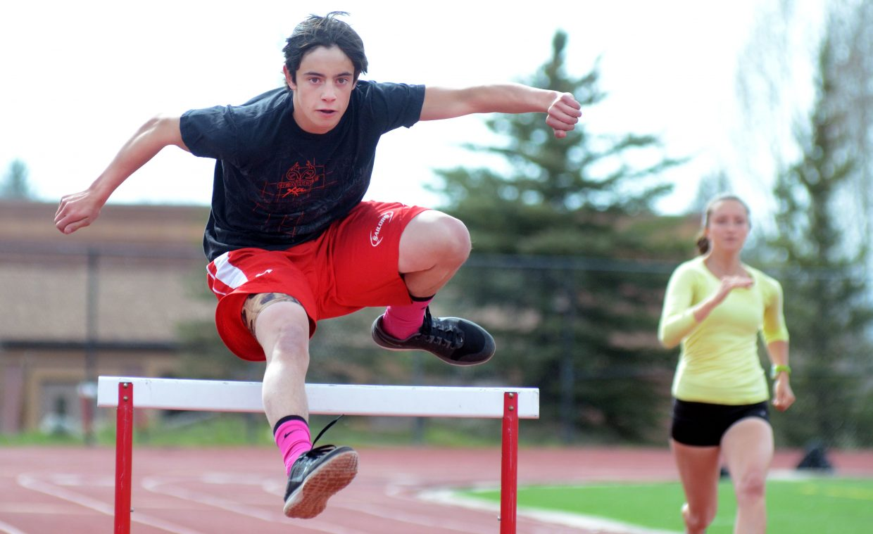 Steamboat Springs High School hurdler Ethan Labriola runs through some track practice drills with Alex Tumminello Wednesday. The Sailors, though shorthanded due to spring break, will be competing in Moffat County's Clint Wells Invitational on Friday.