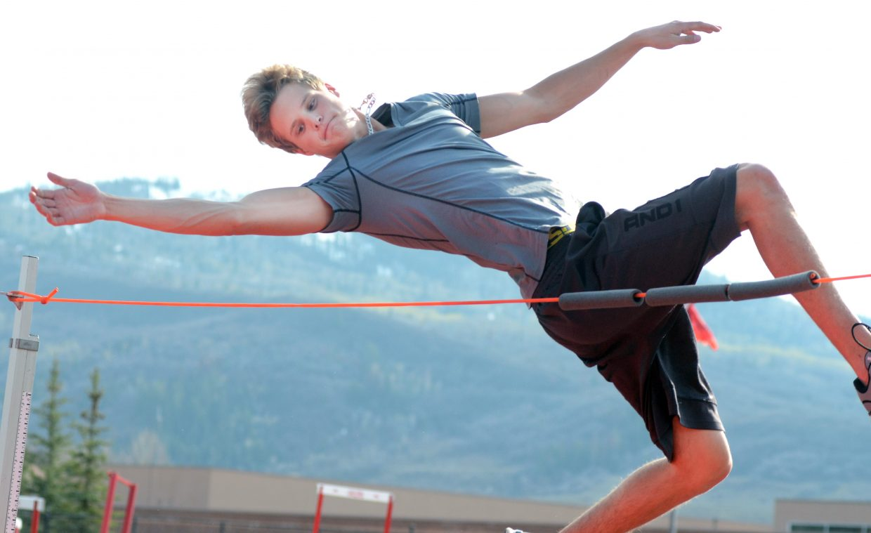Steamboat Springs High School senior Austin Kerbs leaps over the high jump rope during Wednesday's practice. Kerbs cleared 6 feet in his first try in the event, and will have a chance to up his height in Friday's Clint Wells Invitational in Craig.