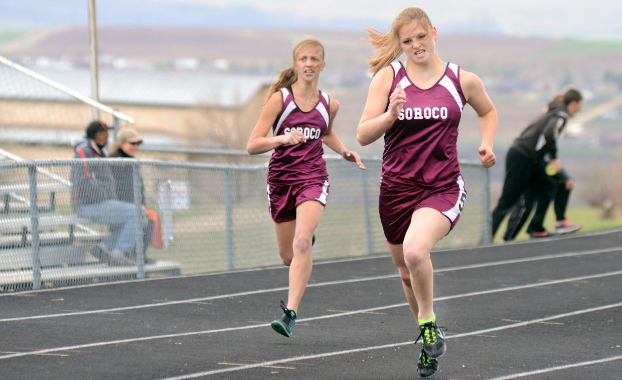 Soroco's Jessica Rossi, right, races down the final stretch of the girls 400 Friday against teammate Charlee Veilleux.