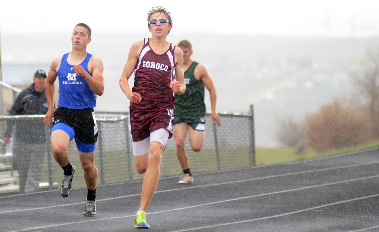 Soroco's Ben Kelley fights off a heavy rainstorm during the boys 400 Friday at the Clint Wells Invitational in Craig. Kelley finished second in the event.