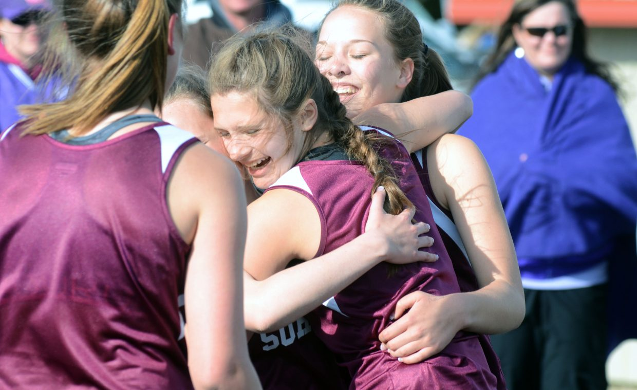 Soroco freshman Mattie Rossi hugs her 4-by-400 relay teammates following the Rams' win Friday at the Clint Wells Invitational in Craig.