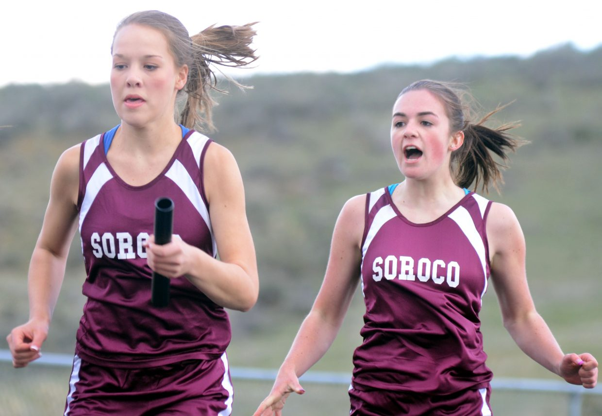 Soroco's Hayley Johnson hands the baton off to Kali Constine in the girls sprint medley on Friday. The Rams won the event.
