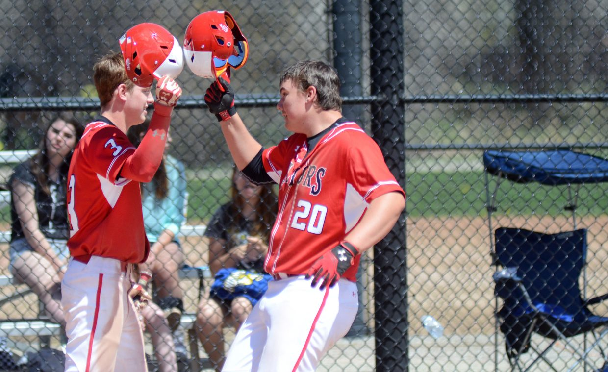 Steamboat Springs' David Brown, right, celebrates a home run with teammate Charley Fitzhugh on Saturday.