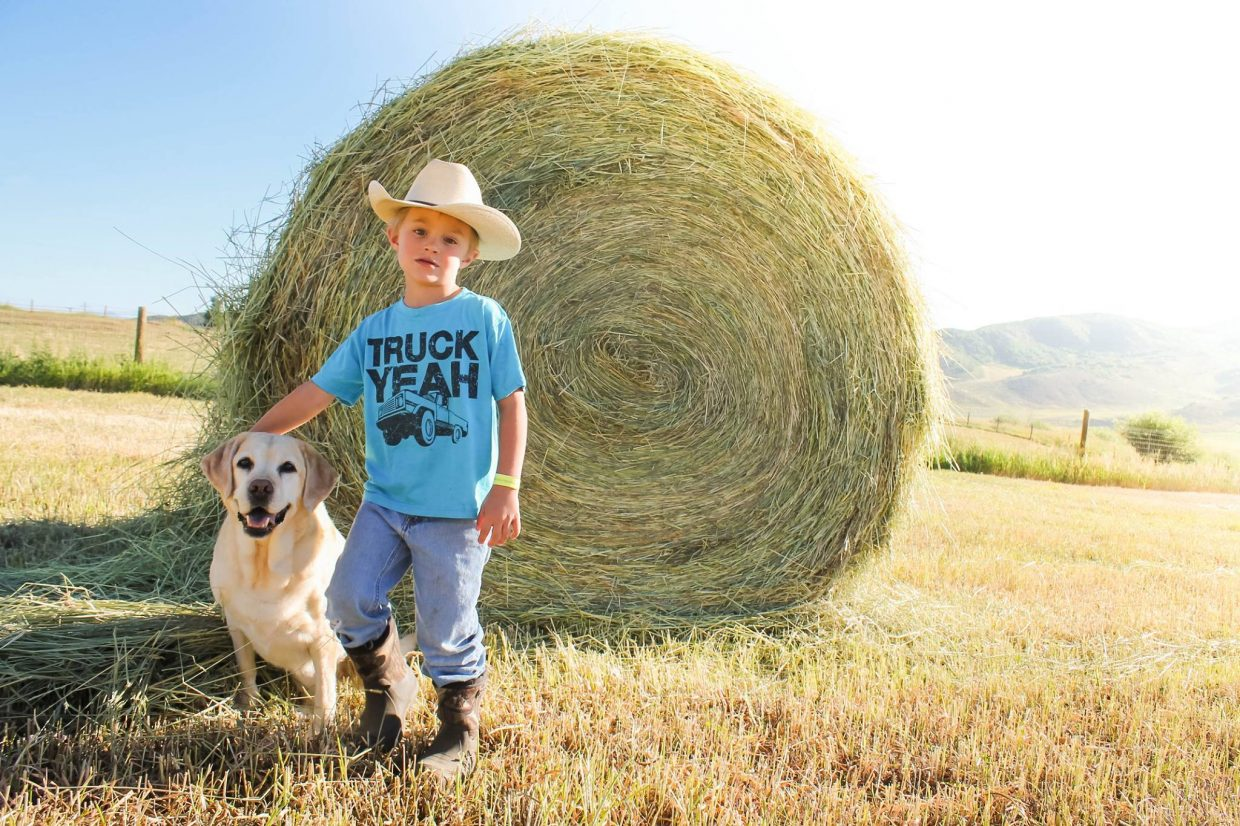 Future rancher Paxton Wilson putting up the hay for the season
