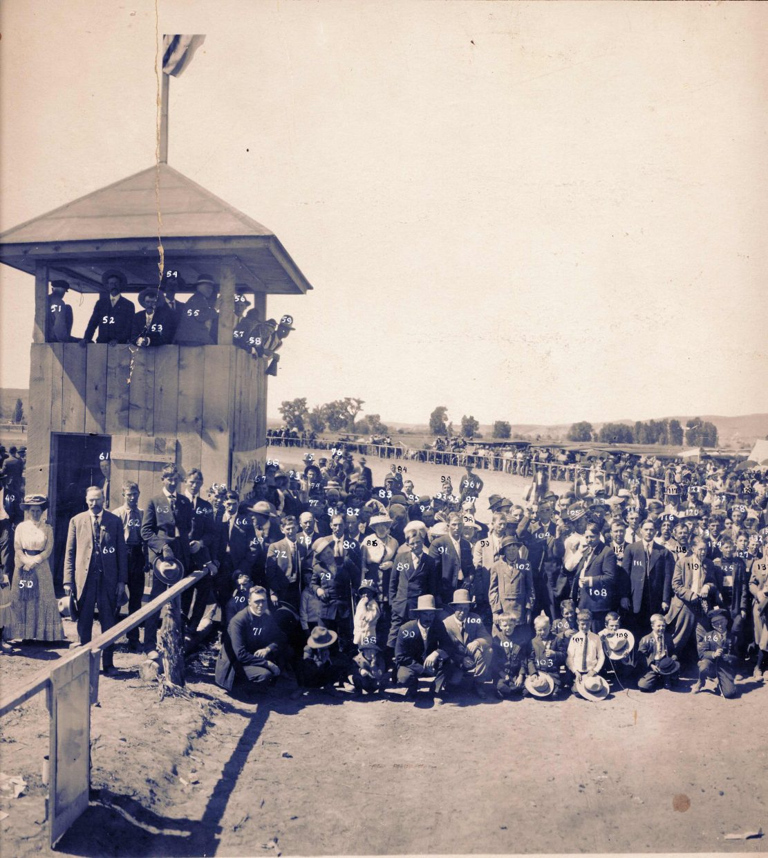 A group of fairgoers gather on the historic race track at the Routt County Fairgrounds in Hayden. This photo was taken at the first fair held in September 1914.