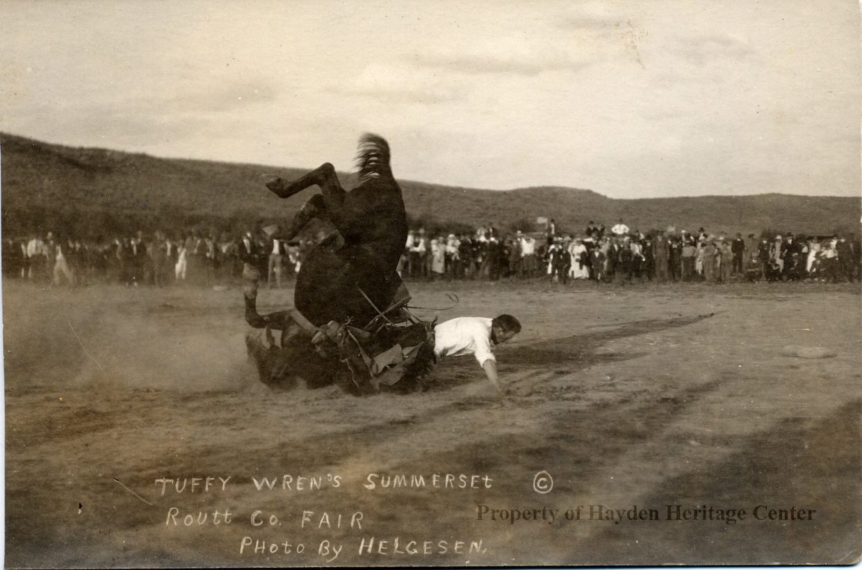 Tuffy Wren, one of the most famous local rodeo cowboys of the early 20th century, competes in the bronc riding contest at the 1915 Routt County Fair.