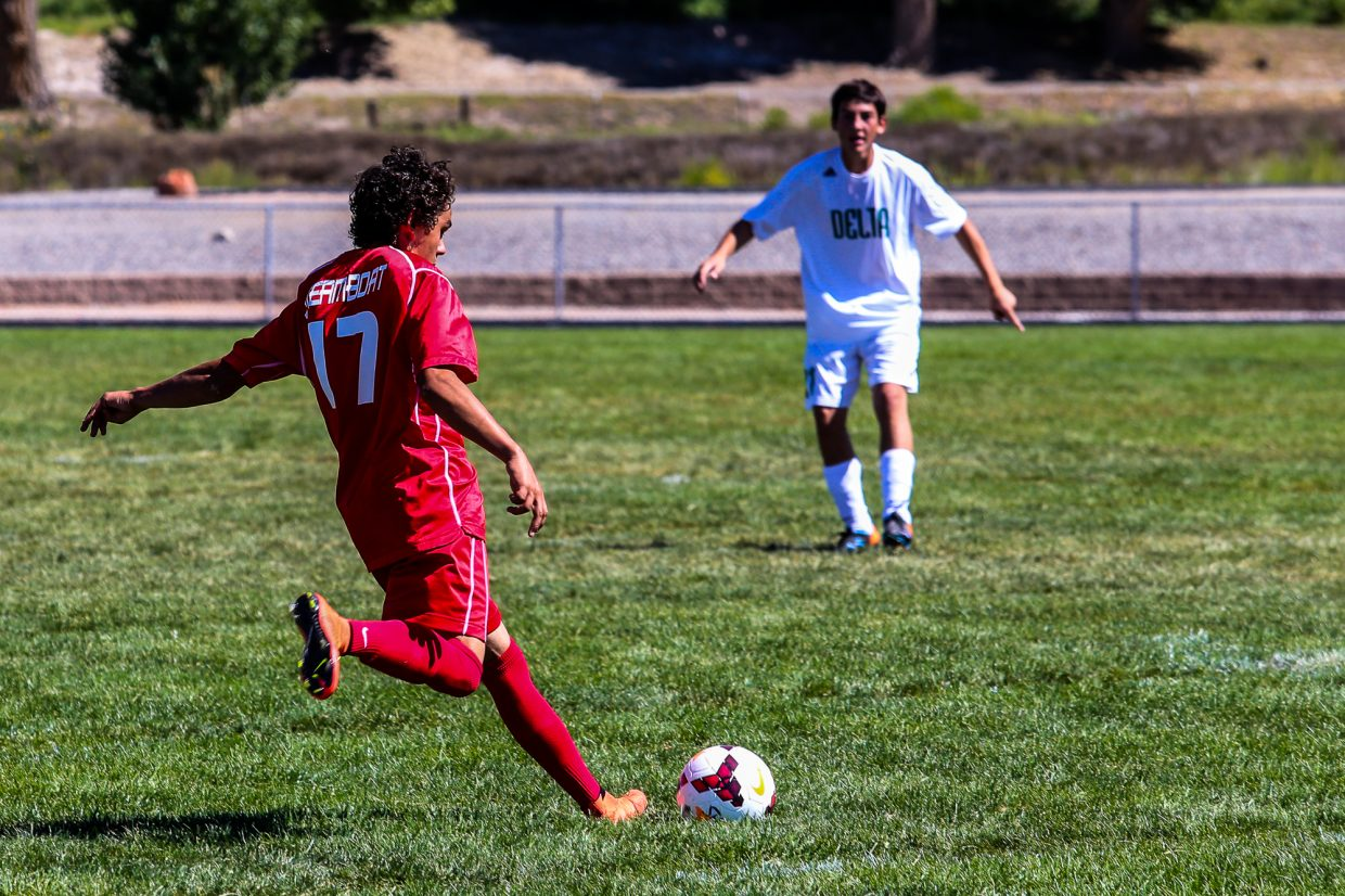 Cruz Archuleta sends in a cross against a Delta defender in the Sailors 3-1 win in Delta on Saturday. Steamboat is now 3-0 on the season and a top the Western Slope League standings. Submitted by: Casey Barnett