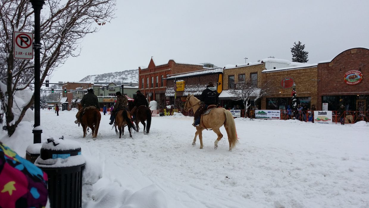 Horses during the Winter Carnival street events. Submitted by Jane Connor.