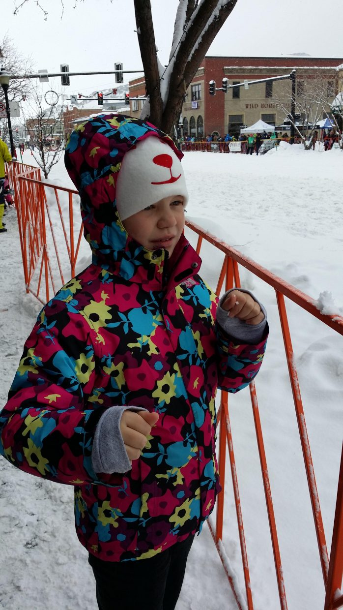 Emma Comerford, of Sydney, Australia, watches Winter Carnival street events. Submitted by Jane Connor.