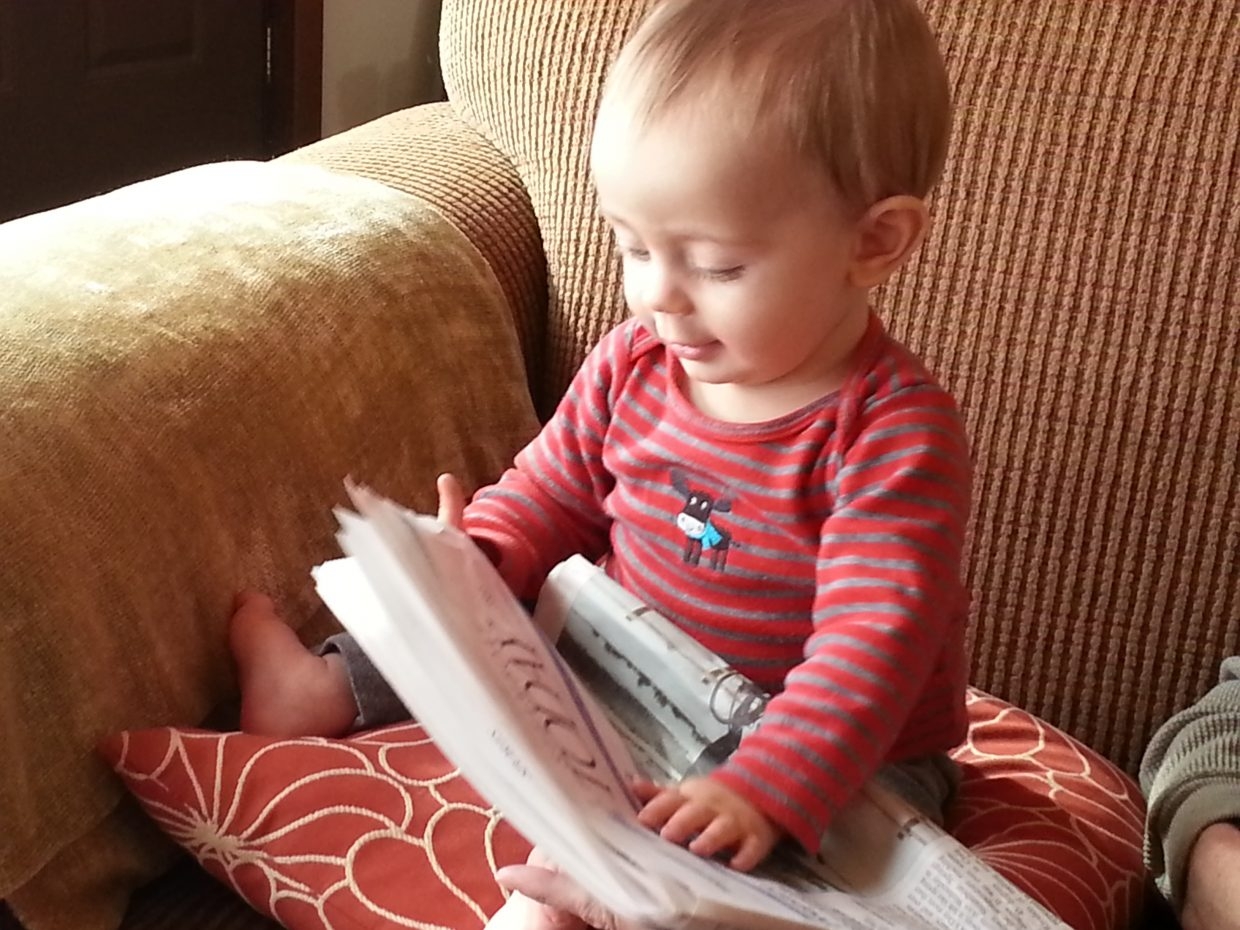 "My son Kaeden Campbell ""reading"" the Today. Submitted by Erin Campbell."