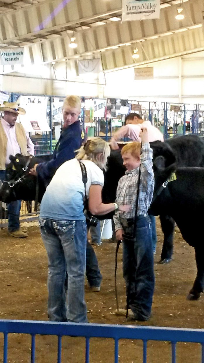A proud mom and son getting ready for the livestock auction at Routt County's 100th annual fair. Submitted by: David Torgler