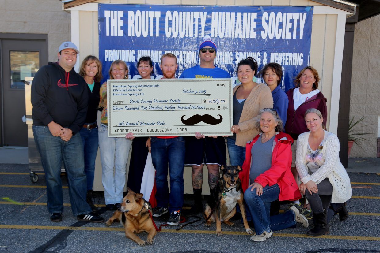 """""""Casey Barnett, Nate Bird, and Rob Peterson present the donation check from the 9th Annual Steamboat Springs Mustache Ride to the staff and volunteers of the Routt County Humane Society. The annual fundraiser contributed $11,285 to the local non-profit from its October 3, 2015 event."""" Submitted by Nate Bird."""