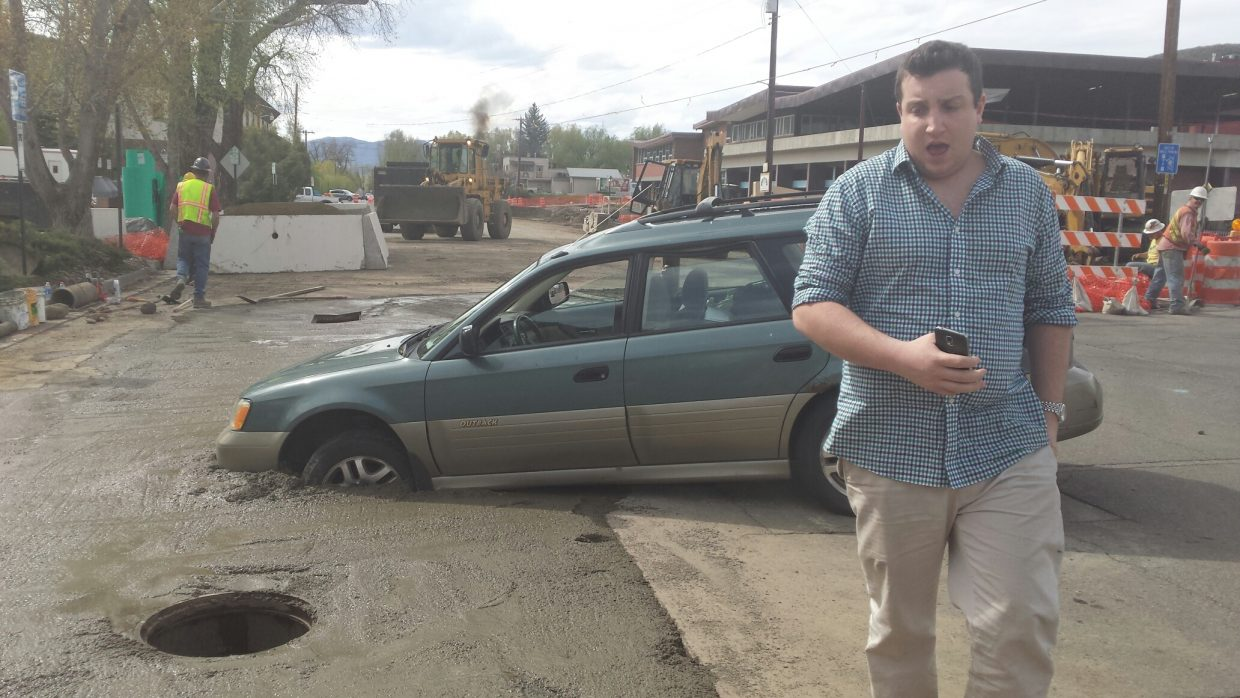 Mike DeGregorio walks away from his Subaru after getting stuck in freshly-poured cement on Yampa Street Friday afternoon.