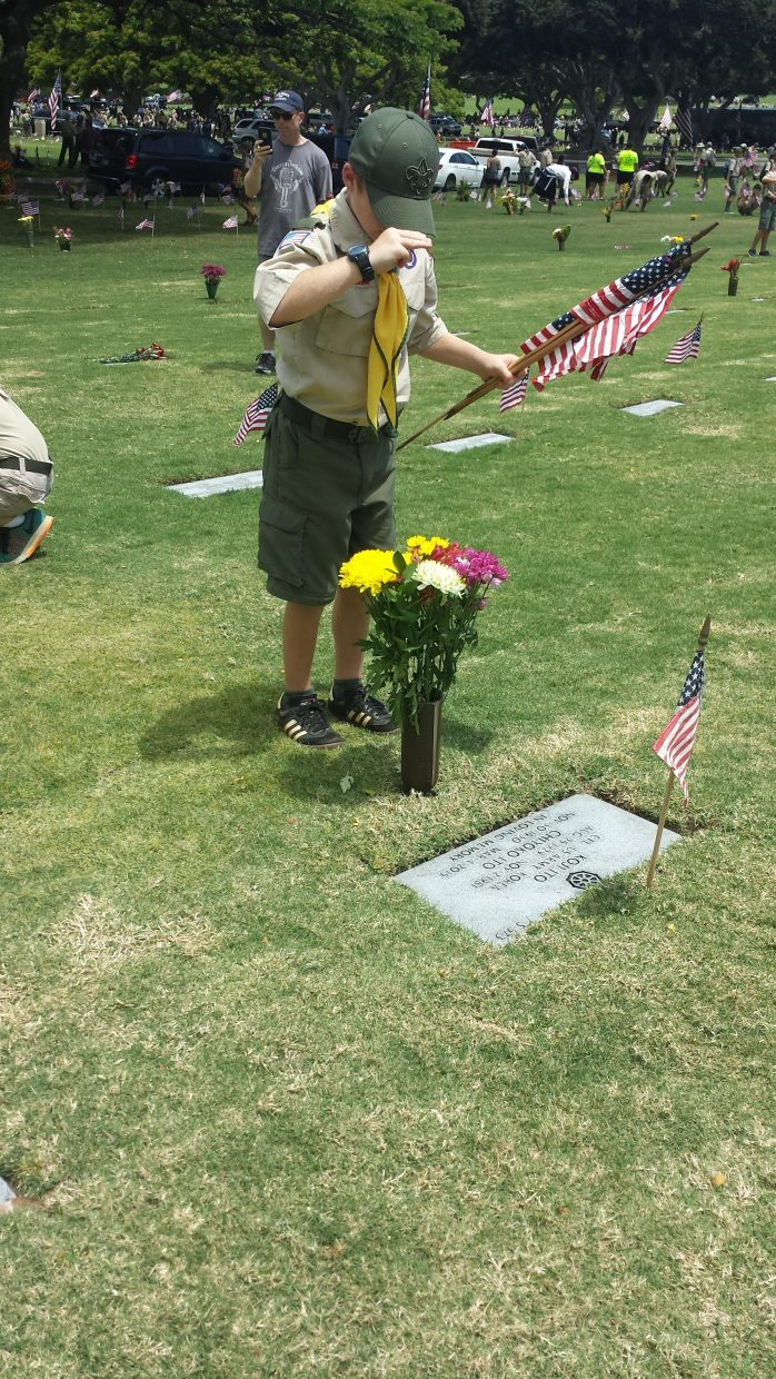 Punchbowl. Boy Scouts placing flags and lei at the National Memorial Cemetery of the Pacific in Punchbowl. Submitted by Sonia Franzel.