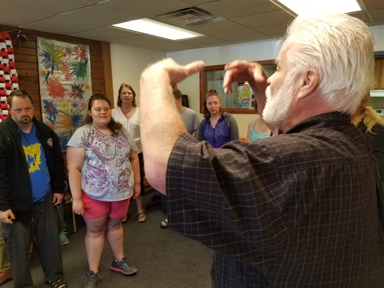 Mark Sauthoff and Jaimee Purcell follow music teacher Dan Comstock in a vocal warmup at Horizons day program. The nonprofit has been working closely with Strings Music Festival to create a sensory-friendly concert.