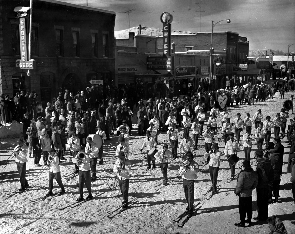Taken in the 1950s, this photo shows a band in front of the Chief Theater for the traditional Winter Carnival event that has been going on for the past 102 years.
