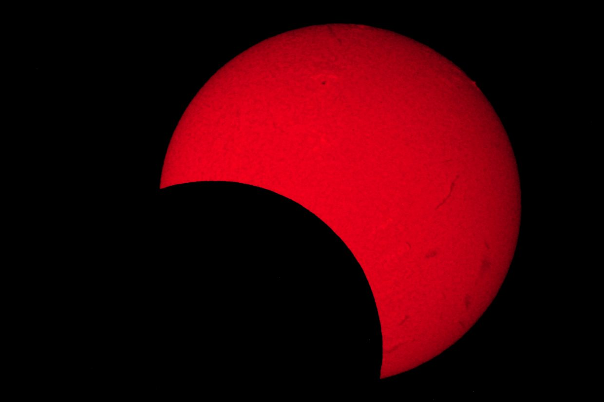 """Thursday afternoon, the moon will sideswipe the sun, creating a partial solar eclipse like the one shown in this image taken May 20, 2012. At maximum eclipse at about 4:35 p.m., 55 percent of the sun will be covered up by the moon. Warning: Never look directly at the sun without a proper solar filter, or permanent eye damage can result. The SKY Club at Colorado Mountain College will host a public """"Solar Eclipse Watch"""" with safe solar telescopes set up for public viewing Thursday afternoon on the CMC campus."""