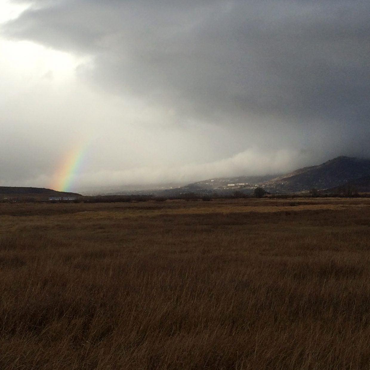 View from the south of rainbow'ette emerging over Dakota Ridge and arcing toward the base of Steamboat Ski Area and lower mountain, photo taken amidst Sunday's squalls around 3:30 MST. Submitted by: Kean Monahan