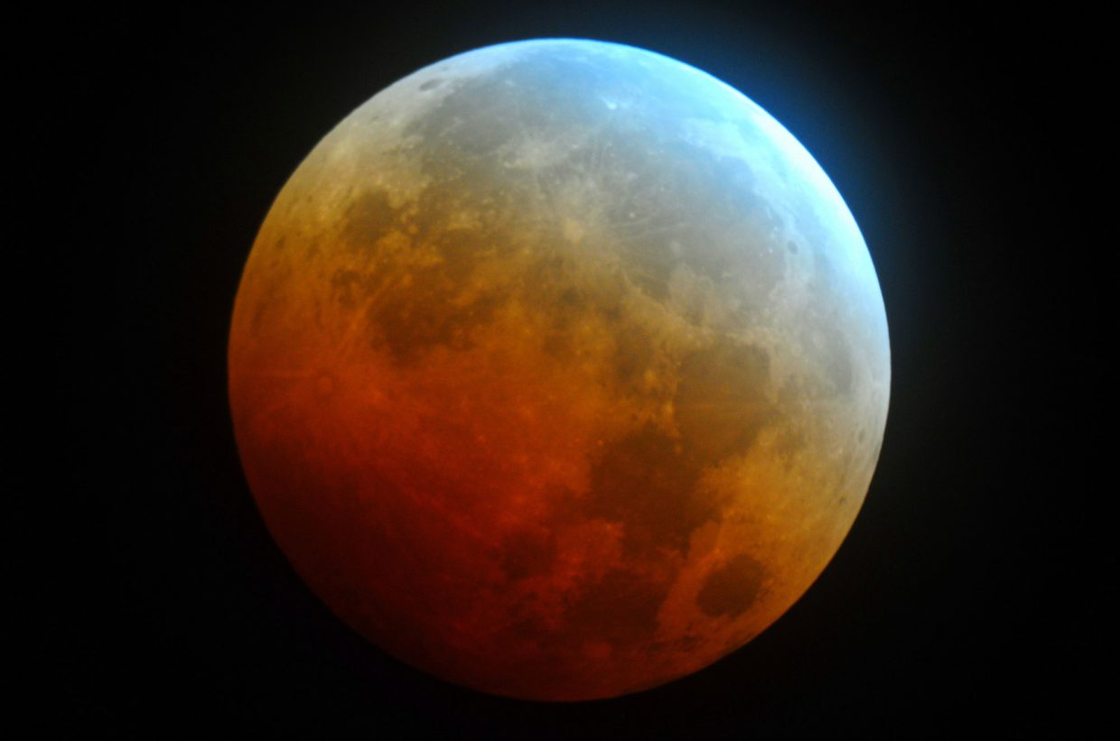 Saturday's total eclipse of the full egg moon might look very similar to the previous eclipse in the current tetrad of lunar eclipses last October. The colors visible on the totally eclipsed moon are caused by filtered sunlight streaming through Earth's atmosphere and onto the moon.