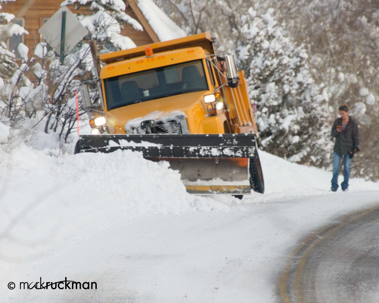 Even snow plows get surprised by the elusive road edge. Submitted by: Mark Ruckman