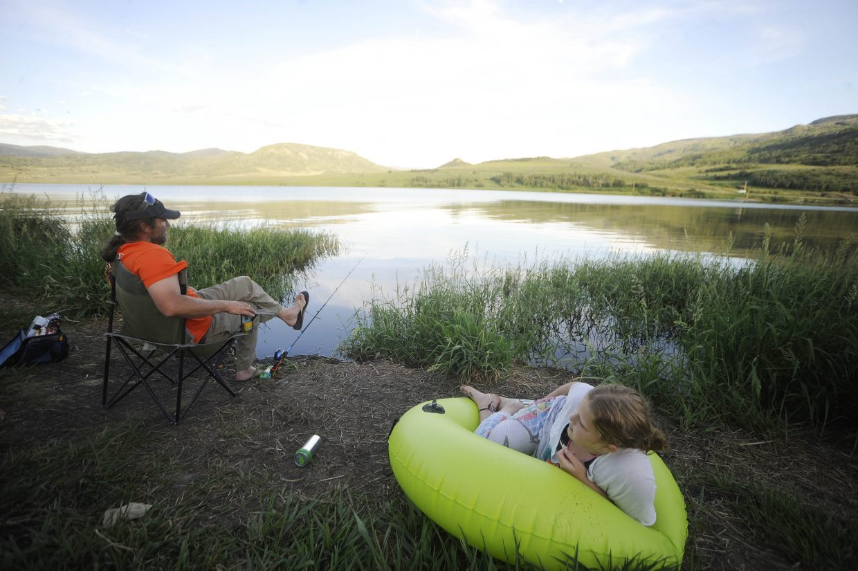 Phippsburg resident Tripp Blalock fishes for trout with his stepdaughter Bailey Miles on Tuesday at Stagecoach Reservoir.