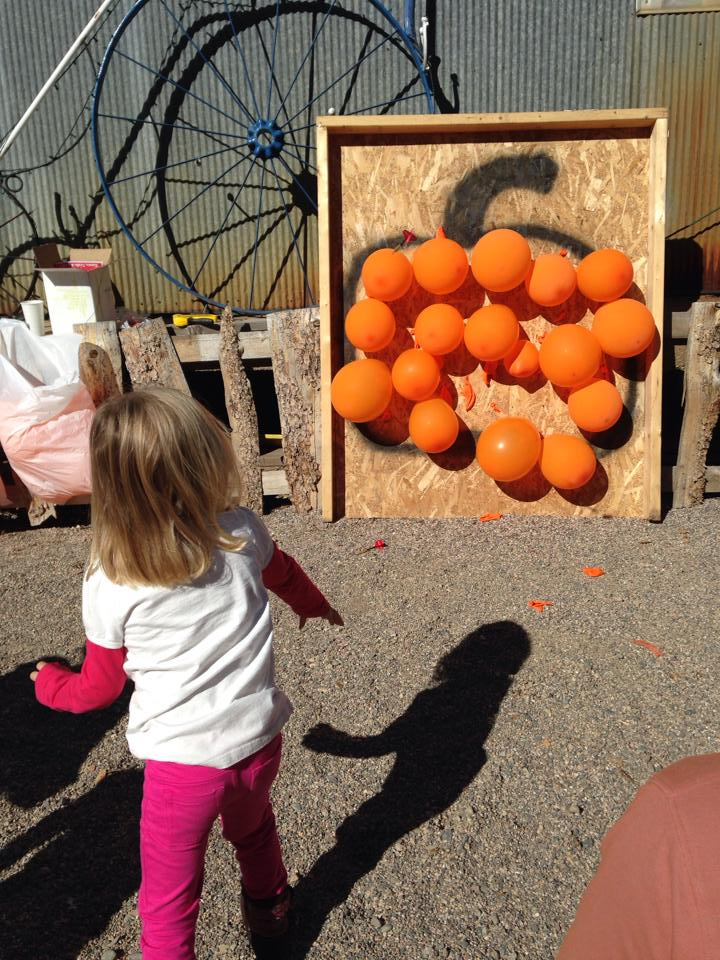 Kids participate in activities such as the balloon pop at the Hayden Harvest Festival, which will be held from 2 to 4 p.m. Saturday.