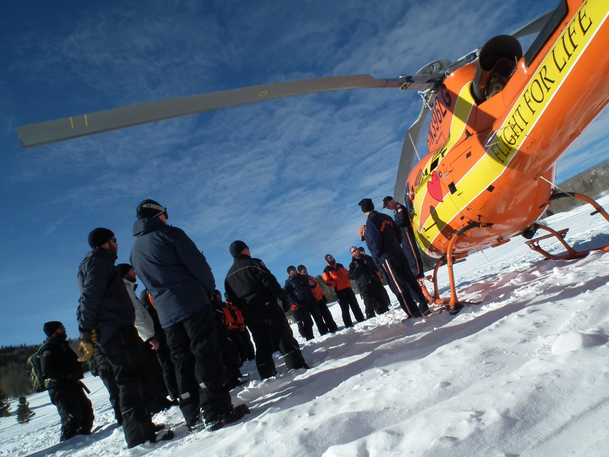 Students from Colorado Parks and Wildlife's Winter Skills Training Academy, based out of Steamboat Lake, learn about air ambulance operations during a rescue scenario in Little Red Park, North Routt County. Submitted by Brent Lounsbury.