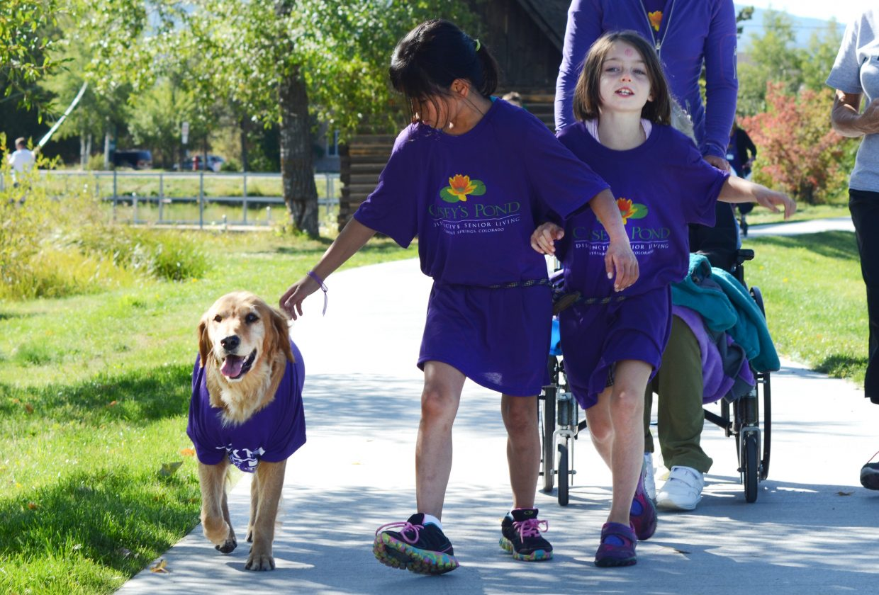 Mea Jenkins, 9, and Ryanne Catterson, 8, get some steps in at the Walk to End Alzheimer's around Casey's Pond on Saturday morning.