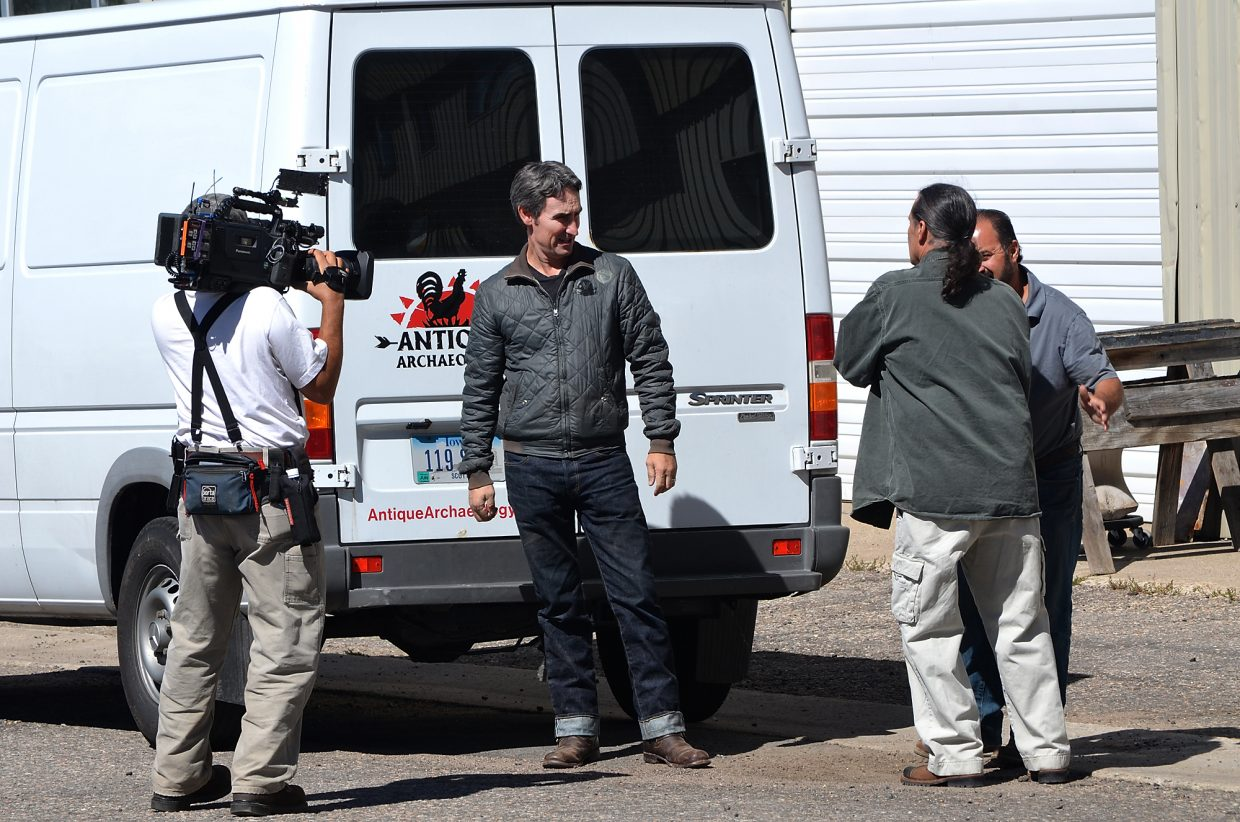 """American Pickers"" stars Mike Wolfe, left, and Frank Fritz, partially obscured at right, bid farewell Wednesday to Steamboat collector, artist and custom sign-maker Donny Woodsmith outside his shop on 13th Street after taping a segment for their television show on the History Channel."