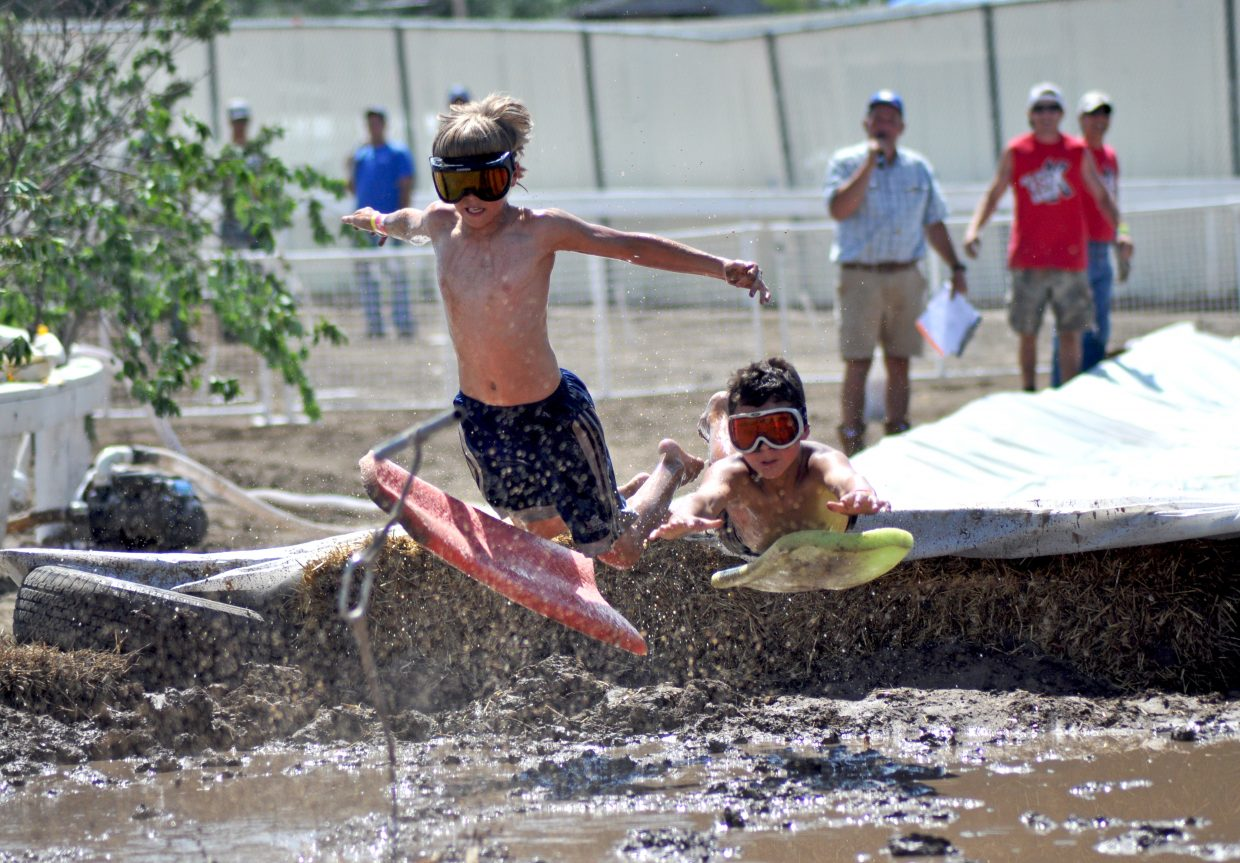 A pair of mudsurfers launch into the mudpit at the 2014 Routt County RedneX Games in Hayden, Colorado. Submitted by: Wendy Lind