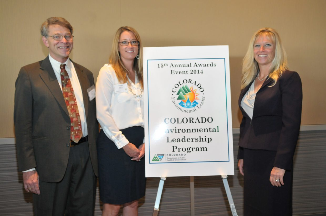 Pictured are David Miller, vice president and leader of the Alpine Bank Green Team; Karrie Fletcher, senior vice president at Alpine Bank; and Lynette Myers, Environmental Leadership Program manager at Colorado Department of Public Health and Environment.