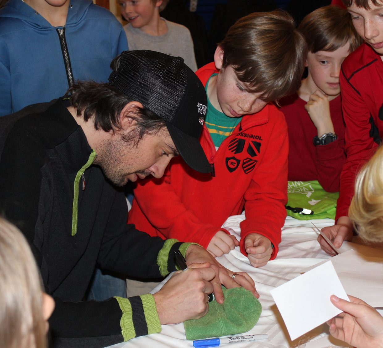 """Johnny Spillane, an Emerald Mountain School alumni who won his third Olympic silver medal in Nordic combined at the 2010 Games in Vancouver, shared his experiences and answered questions for students at the school Wednesday. He talked about how he loved the feeling of flying and about his experiences living in the Olympic Village and meeting other athletes from around the world. Spillane also signed autographs for each of the students. """"We are so fortunate to have such a gracious Olympian willing to give his time bringing the Olympic experience to life for the students at his alma mater,"""" Head of School Sharon Mensing said."""