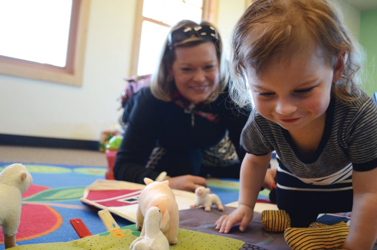 Andrea Queen plays with her 2-year-old daughter, Ava, during a newborn network session held last month at the South Routt Early Learning Center.