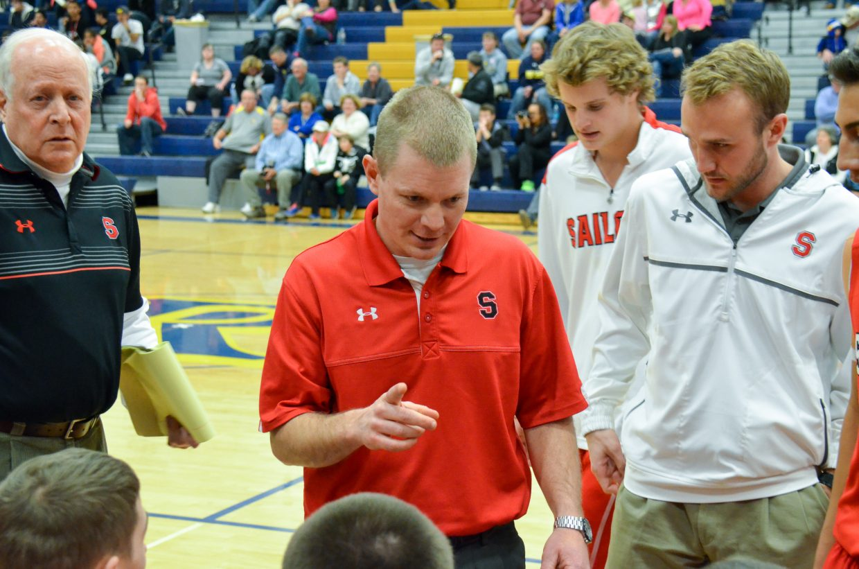 Coach Luke DeWolfe prepares the team for their game against Rifle. Submitted by: Jan DePuy