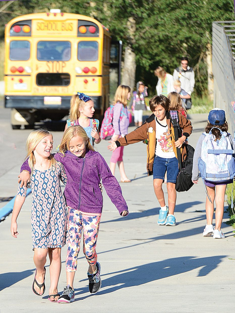 Strawberry Park second graders Micah Wettlaufer, left, and Lexi Iacovetto head back to class Tuesday morning for the first day of the 2017-18 school year in Steamboat Springs. Students from Steamboat Springs and across Routt Country returned to classes Tuesday.