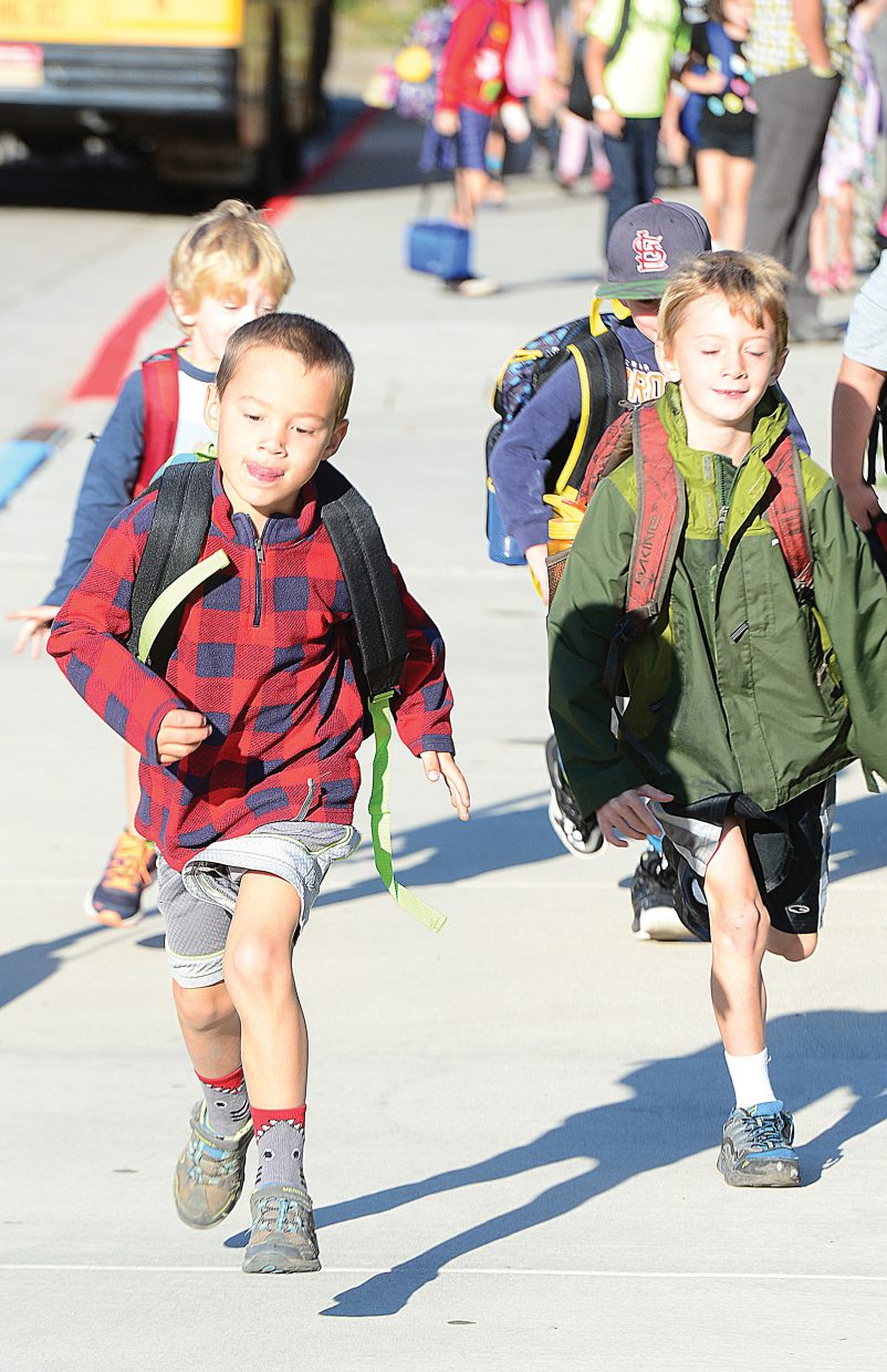 Dean Weinheimer races back to class at Strawberry Park Elementary School after getting off the bus Tuesday morning.