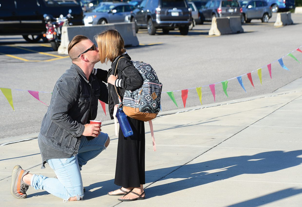 Lily Sublett gets a kiss from her dad Jeff as she heads off to the first day of class at Strawberry Park Elementary School as a fifth-grader.