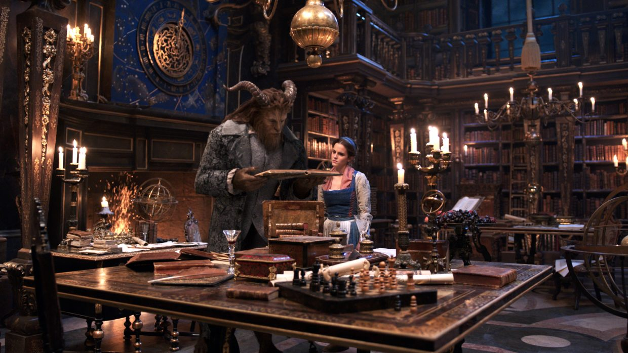 """The Beast (Dan Stevens) introduces Belle (Emma Watson) to his library in """"Beauty and the Beast."""" The movie is a live-action remake of the 1991 Disney cartoon."""