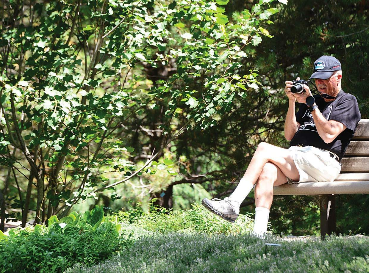 Southern California resident Jim Wellington found a nice bench in the shade to check out the images he captured on his digital camera.