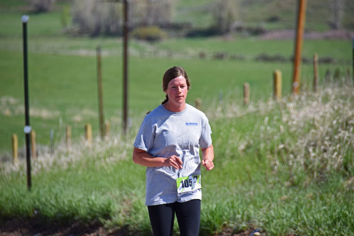 Briana Perkins leads the 2015 Cog Run women's division in the 5k race, taking 1st place with a time of 22min 59sec. Submitted by David Torgler.