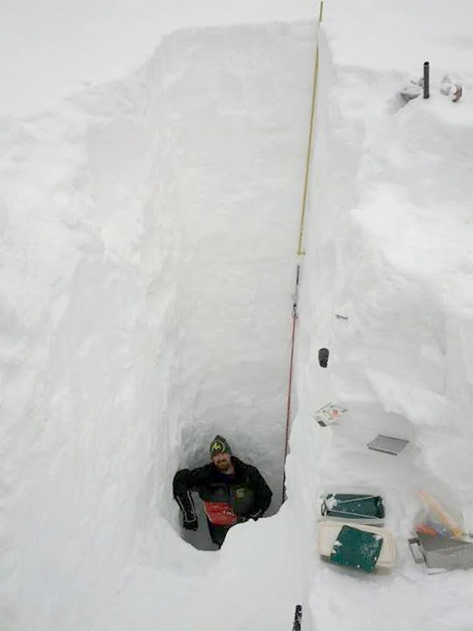 U.S. Forest Service GIS specialist Nick Bencke stands in the bottom of a snow pit east of Summit Lake on Buffalo Pass on April 1, where the snow depth was measured at 194 inches. The snow there is beginning to rival record amounts recorded in spring 2011.
